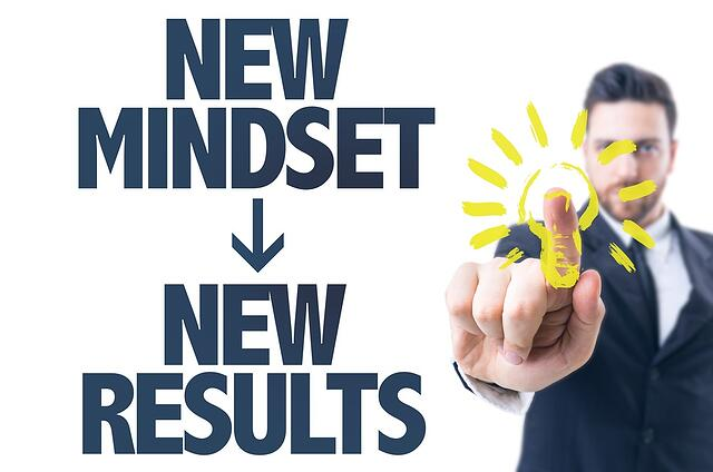 Business man pointing the text New Mindset New Results.jpeg