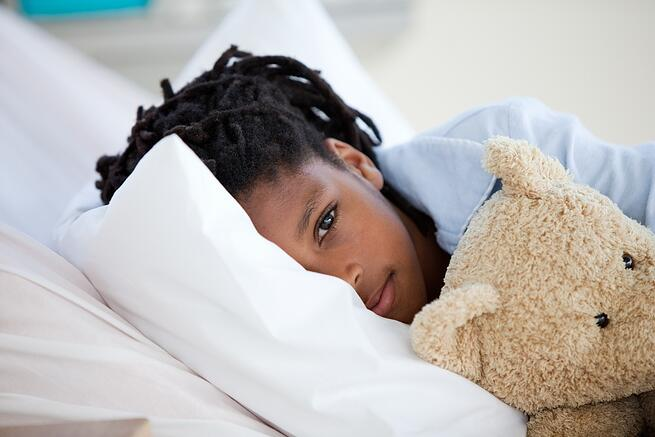 Young Boy in Hospital  hugging his teddy bear.jpeg