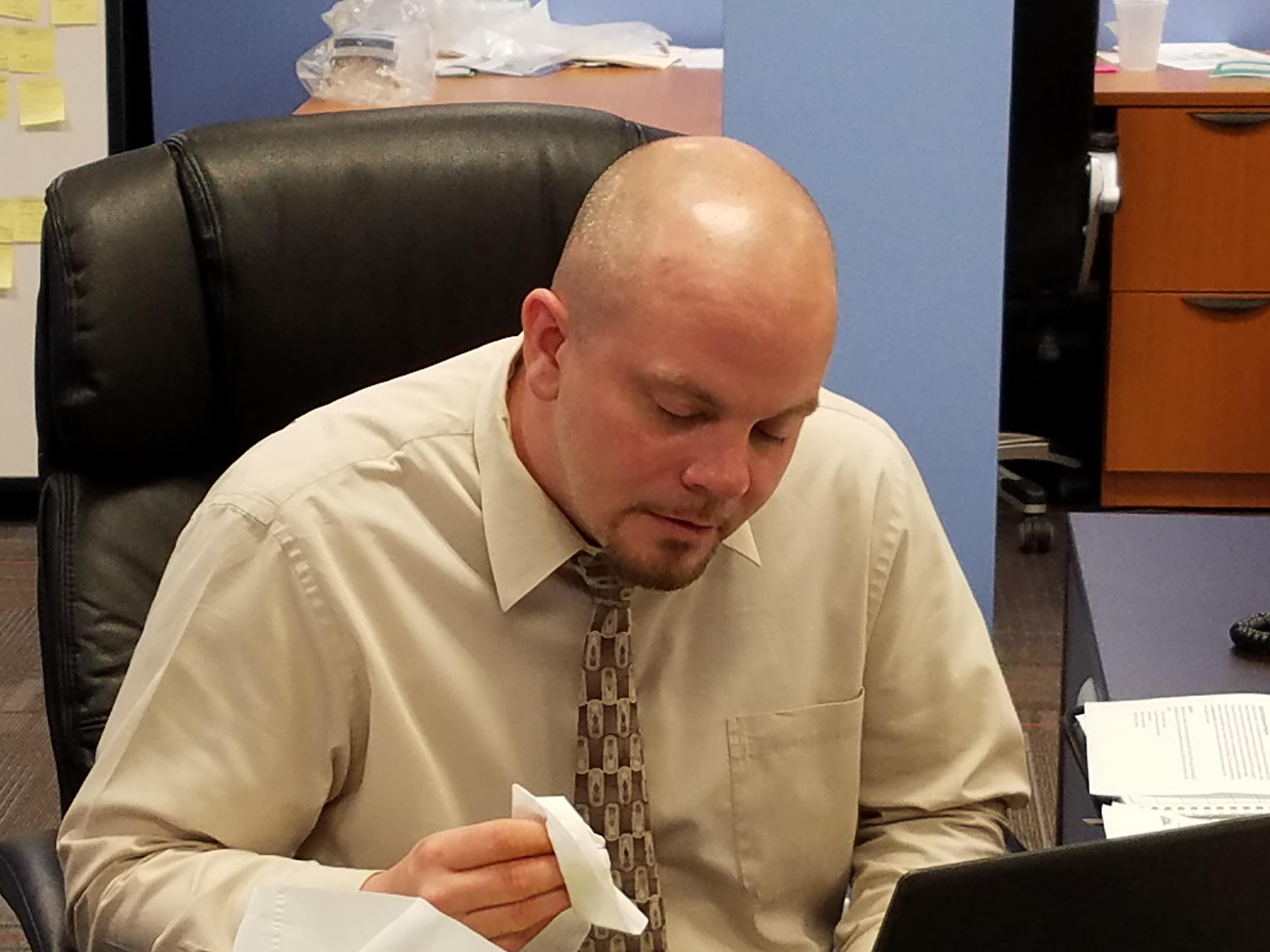 sick employee at desk.jpg
